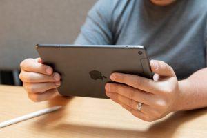 Man playing on iPad